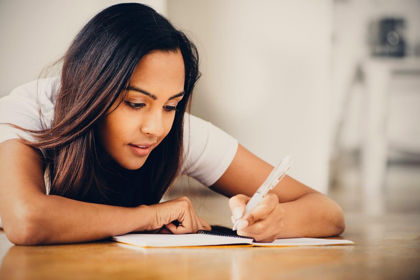 Sexy girl is writing